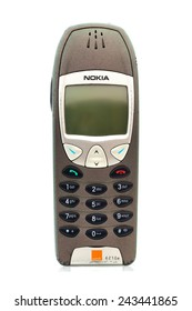 SWINDON, UK - JANUARY 12, 2015: Old well worn vintage Nokia 6210 Mobile Phone on a White Background. Nokia is a Finnish communications and information technology corporation.