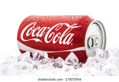 SWINDON, UK - JANUARY 25, 2014: Can of Coca-Cola on a bed of ice over a white background