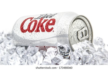 SWINDON, UK - JANUARY 27, 2014: Can of Diet Coca-Cola on a bed of ice over a white background