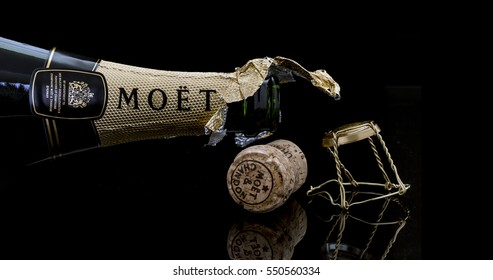 SWINDON, UK - JANUARY 7, 2017: Open Bottle of Moet and Chandon Brut Imperial champagne on a black background