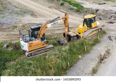 SWINDON, UK - JULY 16, 2019:  Case CX13C Crawler Excavator and Komatsu Bulldozer on a construction site close to the new Deanery School and Waitrose in Wichelstowe, Swindon.