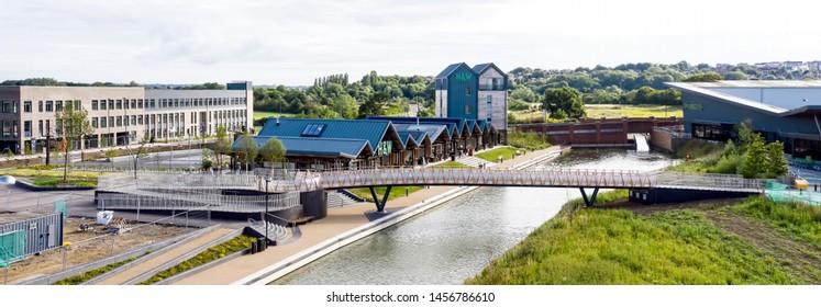 SWINDON UK - JULY 21, 2019: Aerial view of the new foot bridge near H&W the new Deanery School and Waitrose in Wichelstowe in Swindon.