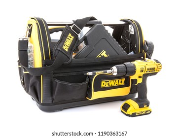 SWINDON, UK - JULY 31, 2018: DeWalt Tool Bag and cordless power tools on a white background