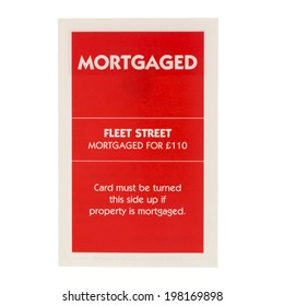SWINDON, UK - JUNE 12, 2014: English Edition of Monopoly Mortgaged Card for Fleet Street,  The classic trading game from Parker Brothers was first introduced to America in 1935.