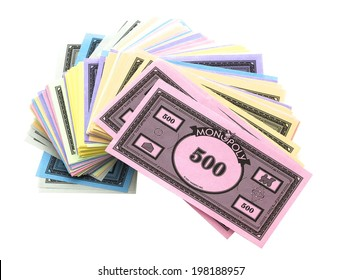 SWINDON, UK - JUNE 12, 2014: Pile Of Monopoly Money on a White Background,  The classic trading game from Parker Brothers was first introduced to America in 1935.