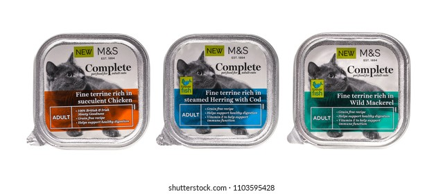 SWINDON, UK - JUNE 2, 2018: 3 Packs of Marks and Spencer Complete adult cat food on a white background.