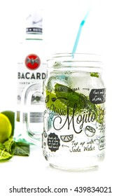 SWINDON, UK - JUNE 20, 2016: Classic Mojito cocktail in a Kilner Mason Jar with a bottle of Bacardi isolated on a white background