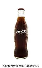 SWINDON, UK - JUNE 22, 2014: Cold Classic Coke Botte on a white background