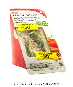 SWINDON, UK - MARCH 12, 2014: Reduced Smoked Ham Salad Sandwich from Marks and Spencer on a white background