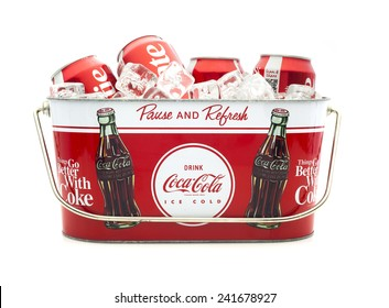 SWINDON, UK - MARCH 29, 2014: Cold Coca-Cola Cans in a Coca-Cola Ice bucket on a white background