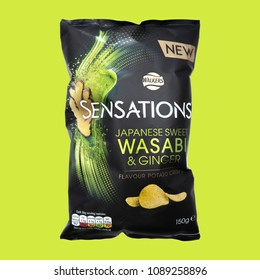 SWINDON, UK - MAY 13, 2018: Walkers Sensations Japanese Sweet Wasabi and Ginger Flavour Potato Crisps on a lime green background