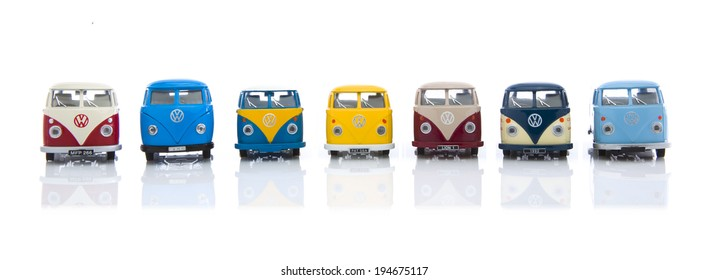 SWINDON, UK - MAY 25, 2014: Collection Of  Old VW Vans Made By Corgi on a White Background