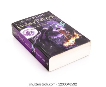 SWINDON, UK - NOVEMBER 18, 2018: Harry Potter And The Deathly Hallows Paperback Edition on a white background