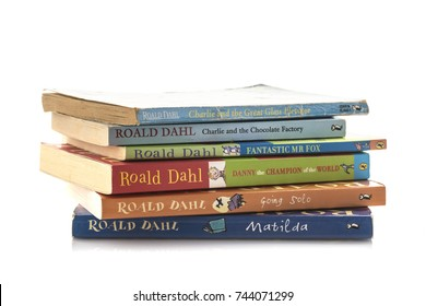 SWINDON, UK - OCTOBER 29, 2017: Pile of old Roald Dahl books on a white background