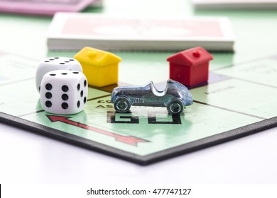 SWINDON, UK - SEPTEMBER 3, 2016: English Edition of Monopoly showing Pass Go,  The classic trading game from Parker Brothers was first introduced to America in 1935.