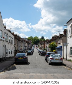 Swindon, United Kingdom - May 04 2019:   Looking up the hill past cars and houses to the park at the end of Deacon Street