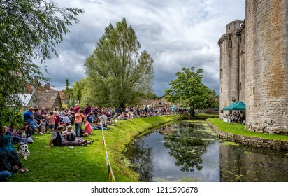 Swing band performing in front of Nunney Castle and moat in Nunney, Somerset, UK on 1 August 2015