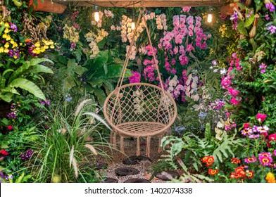 swing basket hanging chair in flower garden