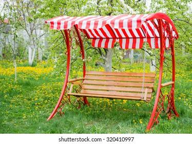 Swing bench in garden.