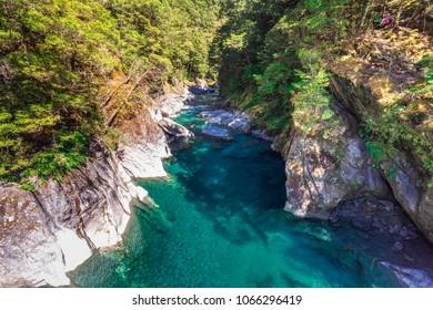 The swing bridge on Blue Pool in Wanaka, New Zealand.