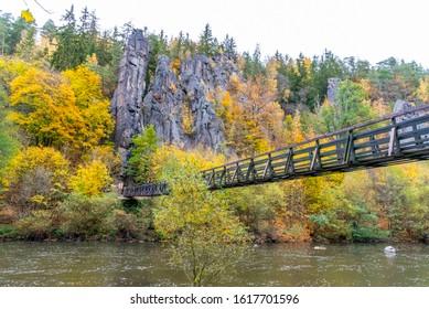 Swing Bridge over Ohre River at Svatos Rocks, Czech: Svatosske skaly, at autumn time, Czech Republic. - Shutterstock ID 1617701596