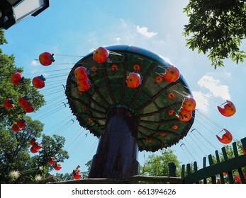 Swing carousel in amusement park. Attraction in Familypark. St. Margarethen, Burgenland, Austria, June 2017.
