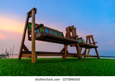 swing chair on green artificial grass with twilight sky