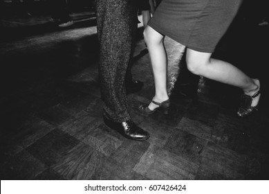 swing dancers in black and white vintage dresses