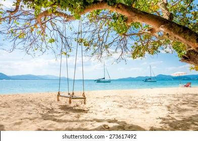 Swing hanging under the tree at Rang Yai island, Phuket, Thailand