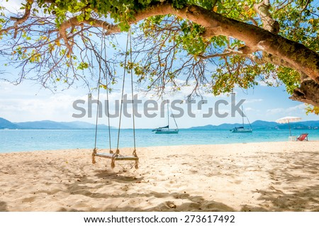 Swing hanging under the tree at Rang Yai island, Phuket, Thailand