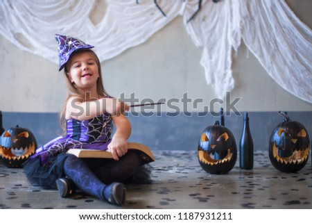 48564a4ee2fe Swing the magic wand. Dressed in a carnival girl. Carnival costume of a  witch