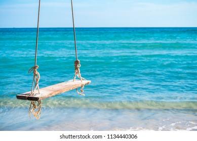 Swing on beautiful tropical island beach summer holiday - Koh Kood, Trat Thailand