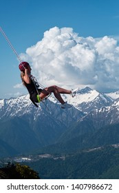 swing over the chasm on Rosa peak, 2320 meters surroundings Sochi Russia may 18, 2019