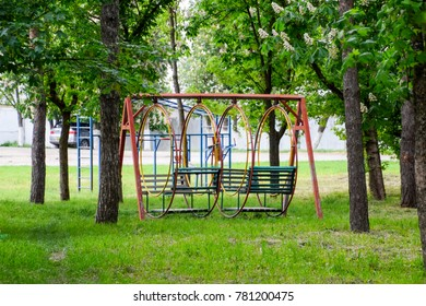 swing in the park. Playground for children's games in the park. Swing round