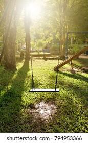 Swing in playground at beautiful sunset.