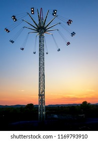 Swing ride. Star flyer. Amusement ride in sunset.