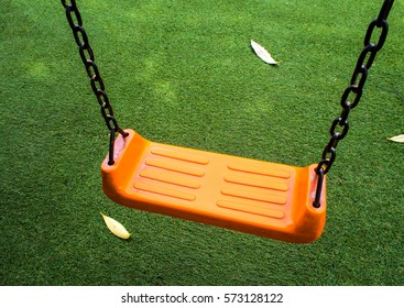 Swing seat on the artificial grass