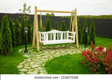 Swinging bench in the garden