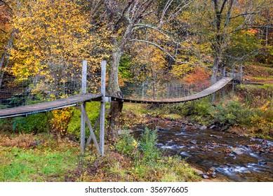 Swinging bridge and fall foliage in Southwestern Virginia