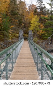 Swinging bridge at Jay Cooke State Park in Autumn