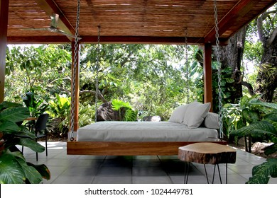 Swinging outdoor bed