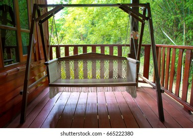 swings or hammock at balcony of bungalow which Surrounded by Shady nature for relax