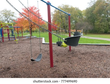 Swings on a kids playground in the park