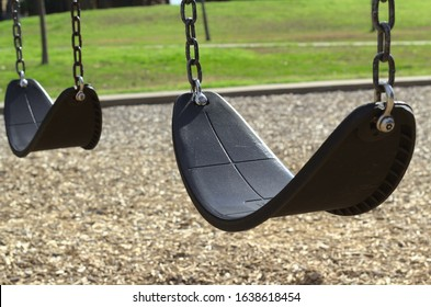 A swingset in a sunny park