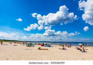 SWINOUJSCIE, POLAND - JULY 6, 2014: Panoramic view of crowded Baltic sea beach on Usedom island in Swinoujscie, Poland