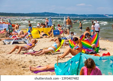 Swinoujscie, Poland - July 7, 2014: People relax on a crowded Baltic sea beach on Usedom island in Swinoujscie city, Poland