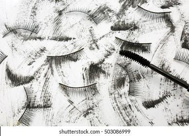 swirl black mascara on white background