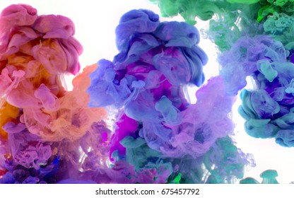 Swirl multi color smoke moving underwater. Abstract color background