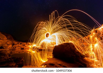 Swirl Steel Wool light Photography  over the rock and water at night  Sam Phan Bok.Photo by long exposure with noise and grain.