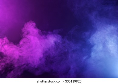 Swirling fog lit with pink and blue gels to create a multicolored background texture.